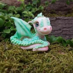 Dragón blanco y verde